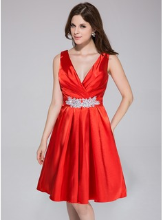 A-Line/Princess V-neck Knee-Length Charmeuse Bridesmaid Dress With Ruffle Beading