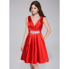 A-Line/Princess V-neck Knee-Length Charmeuse Bridesmaid Dress With Ruffle Beading