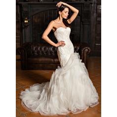 Trumpet/Mermaid Sweetheart Sweep Train Organza Wedding Dress With Beading